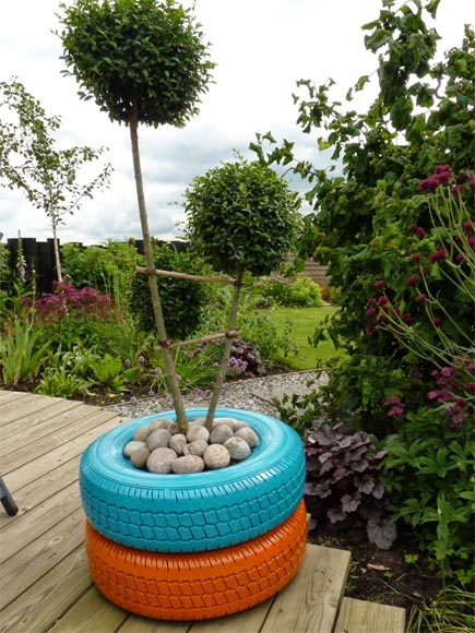 Painting old tyres turquoise is a great way to add colour to your garden