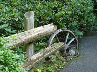 This upcycled wheel makes a great handrail in a garden in Canada
