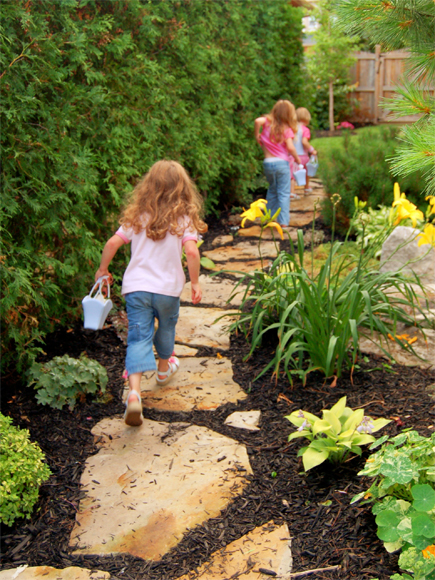 Children marching on stepping stones