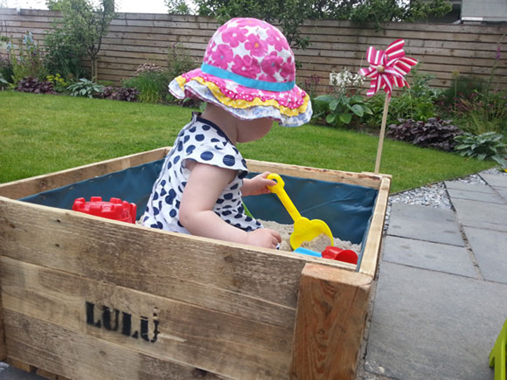 Make your own sand pit from an old pallet