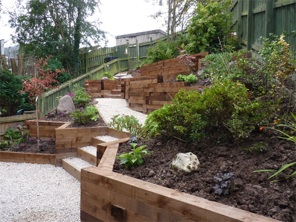 A terraced garden using sleepers for a softer, more natural look. Designed and built by Vialii