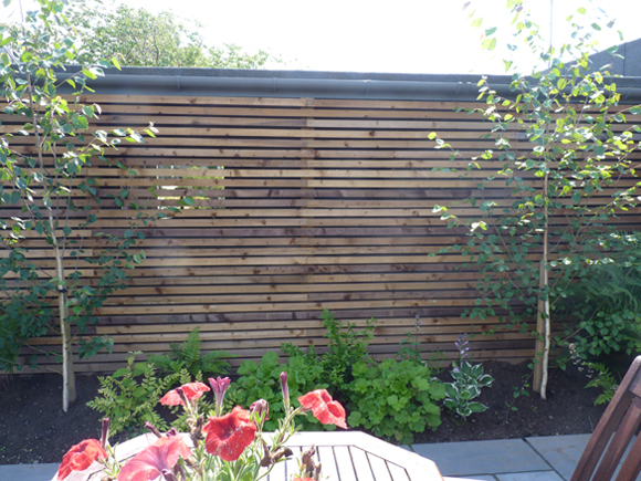After: a stylish screen provides a lovely backdrop to the new patio