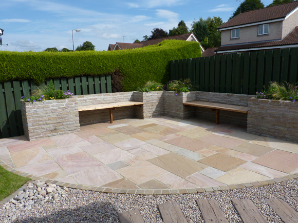 After: a large sandstone patio for entertaining is a key part of the new garden