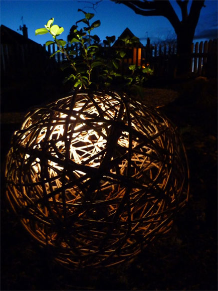 A willow ball with lighting set inside creates a wonderful focal point at night time