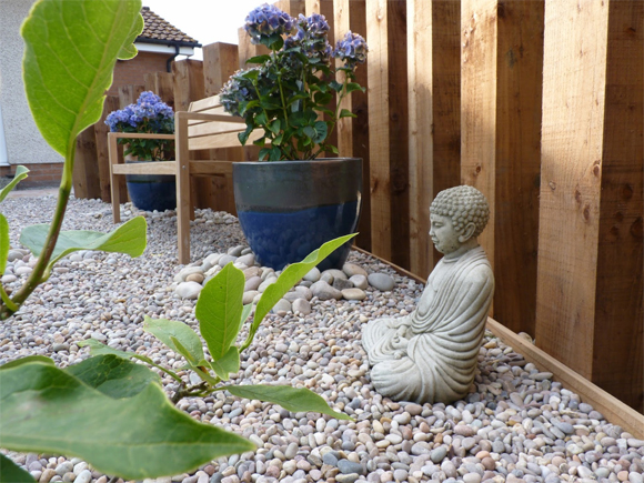Adding gravel, pebbles, pots and statues in soggy areas can overcome the problem
