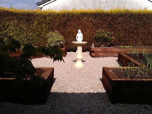A formal layout is complemented with this classical statue focal point