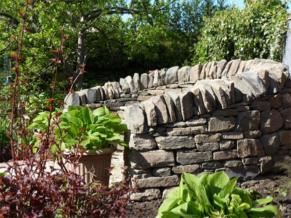 A dry-stane seat creates a wonderful focal points as well as a place to rest on your journey round the garden