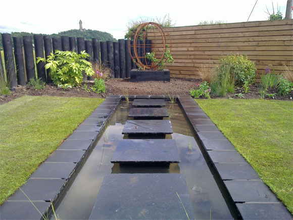 Here, the water feature and metal globe draw the eye up to the beautiful views beyond