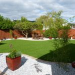 Curving lawn, a new patio and structural planting transforms this garden