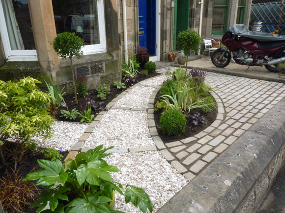 After: even in a small garden journeys can be created and interest added