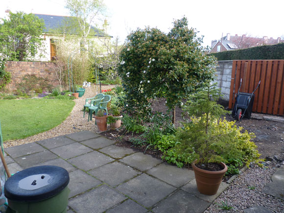 Before: with the removal of the garage, the garden badly needed tackling