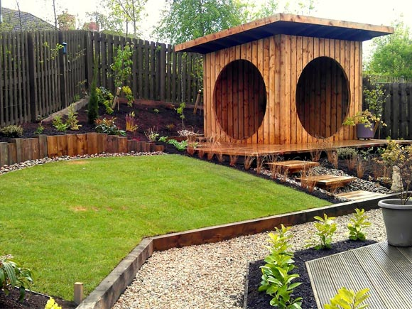 "The garden ""pod"" is a great focal point in this garden as well as somewhere to shelter from the weather"