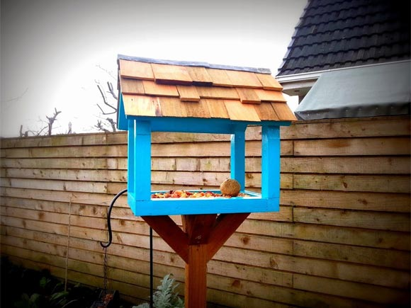 The upcycled bird table has a cedar roof and lead flashing!