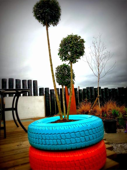 Old tyres can become an eye catching garden feature