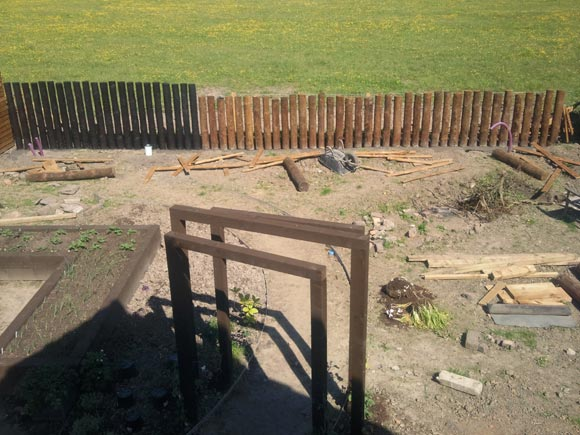 The fencing, veg beds and archway take shape