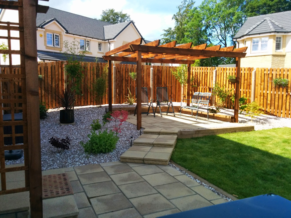 The pergola gives added privacy in this family garden