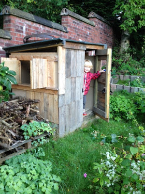 Euan in his wonderful, upcycled playhouse