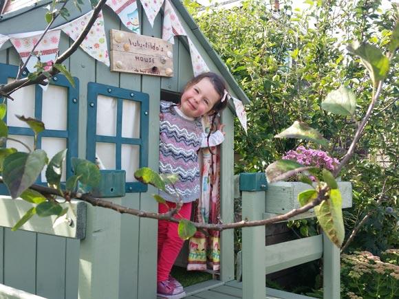 My playhouse nestles in between two apples trees