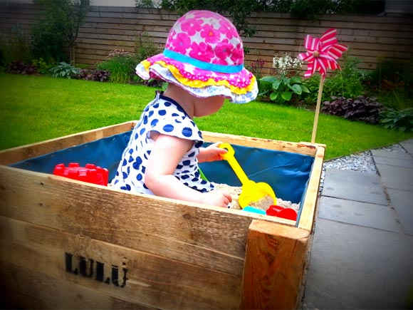 You can make a sandpit out of old pallets if you are clever like Daddy