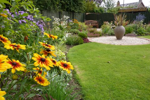 The new borders, curving path and feature pot