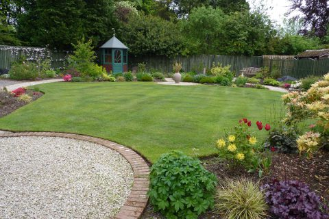 The re-shaped lawn with the renovated summerhouse beyond