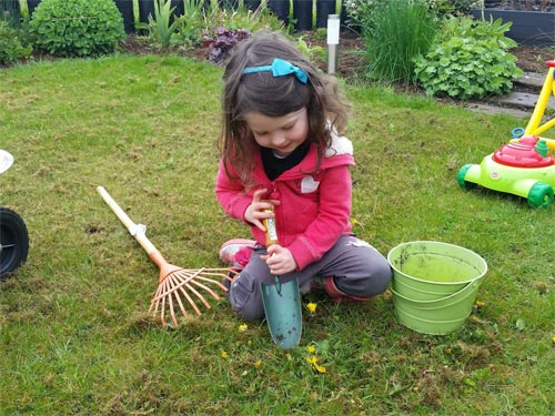 Tackle those weeds using a trowel and some muscles