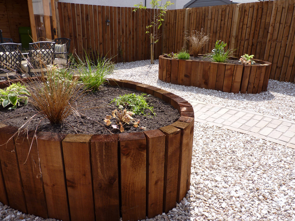 Using vertical timbers allows the raised beds to be beautiful ovals