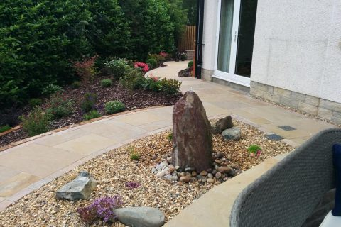 The standing stone in its alpine bed