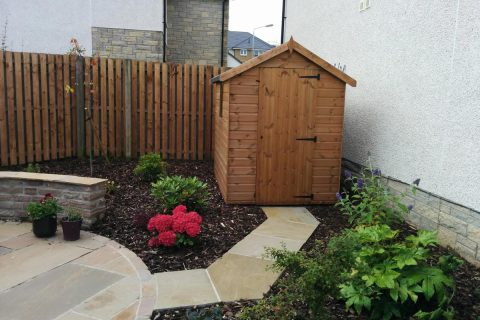 A shed is tucked round the corner