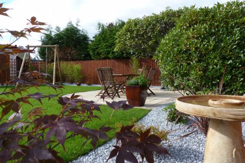 Bird baths, decorative balls and planters add interest to the gravel