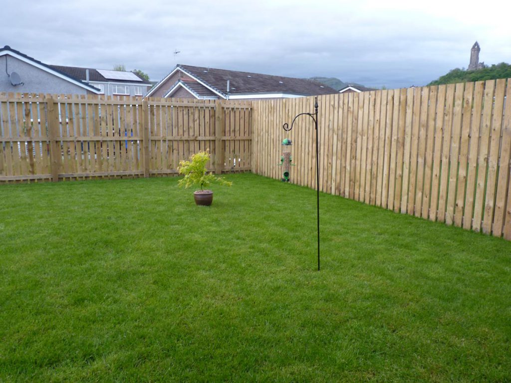 Before: just lawn and single slatted fence