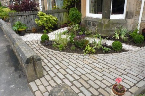 The cobbled path leads you around the garden