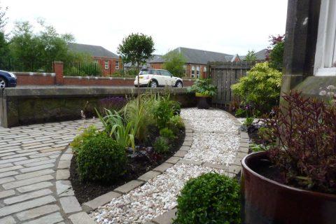 The cobble path changes into a gravel path