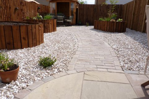 A cobble path leads you through the garden