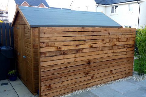 A timber screen helps disguise the shed