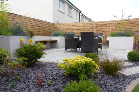 A slate finish to the borders make them low maintenance
