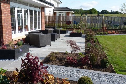 The new grey sandstone patio