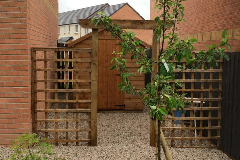 The utility area is screened by some trellis