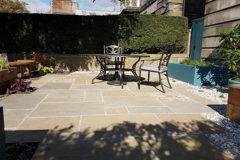 The sandstone paving with brick detailing