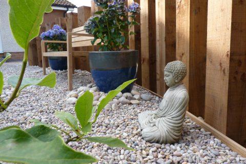 Sculpture pots, pebbles and planting nestle together