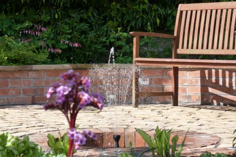 A sunny spot to sit beside the new water feature