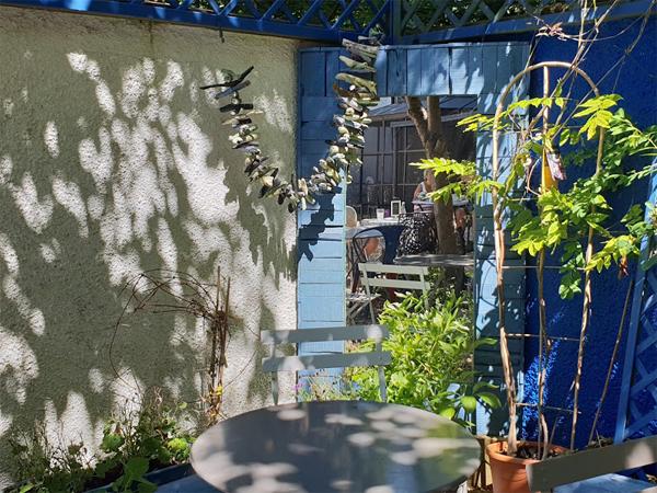 A garden trompe l'oeil can make a garden look bigger
