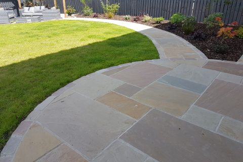 """Harvest"" sandstone patio edged with setts"