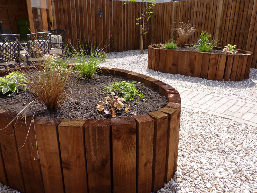 We designed & built these lovely curving raised beds