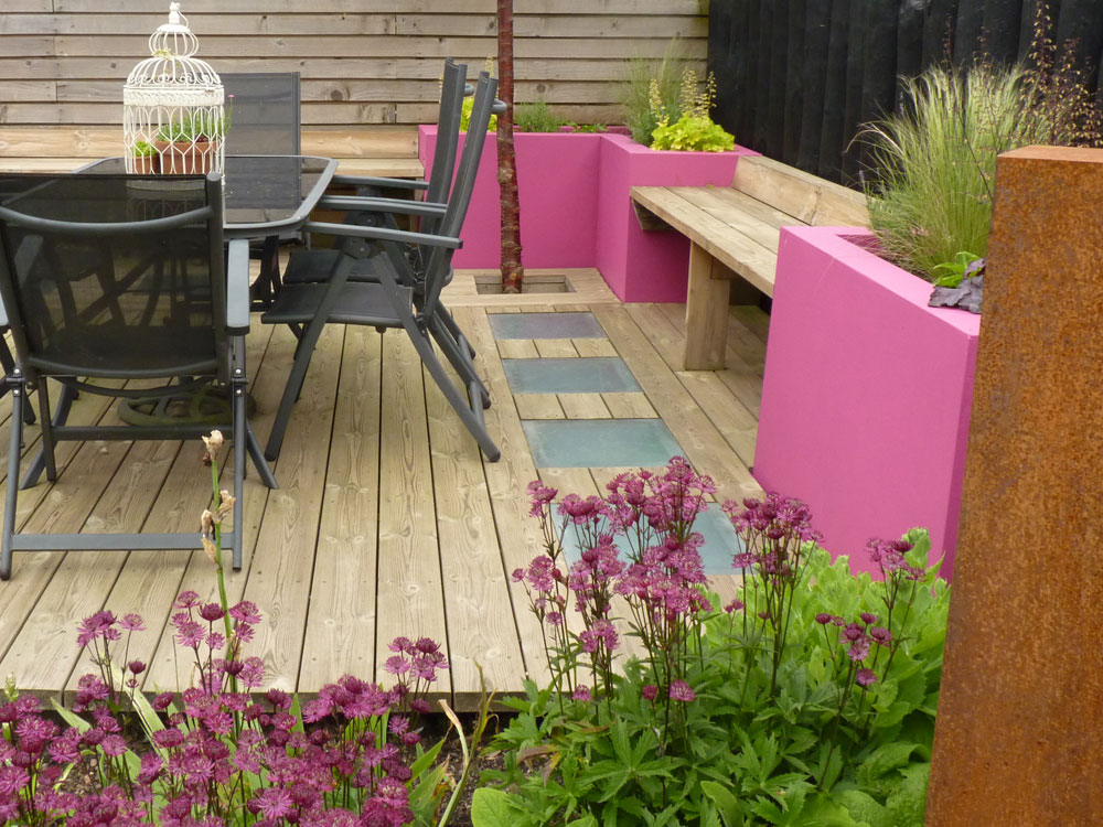 Adding colour to your rendered raised bed can change the feel of your garden