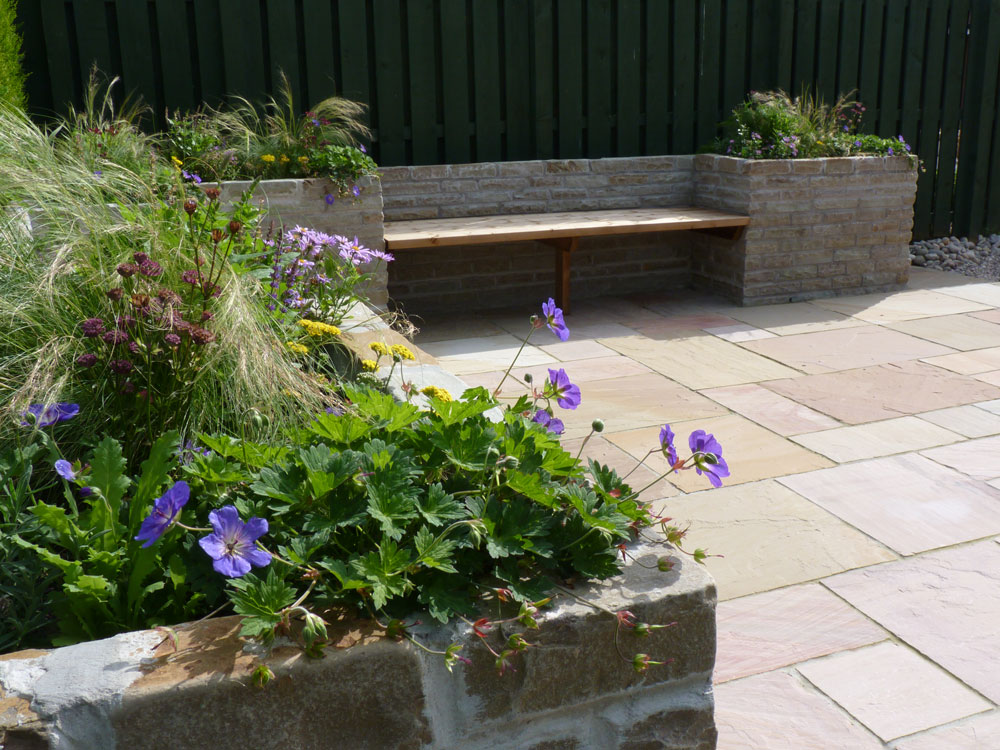 Beautiful sandstone creates a more rustic raised bed