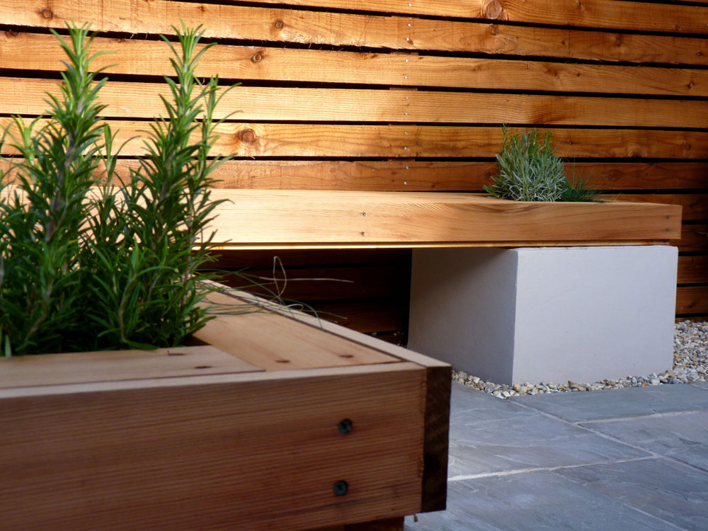 Stunning hardwood creates the perfect finish to these rendered raised beds