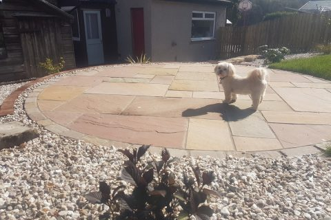 Gus shows off his new sandstone patio