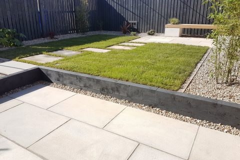 Stepping stones through the lawn link the patios