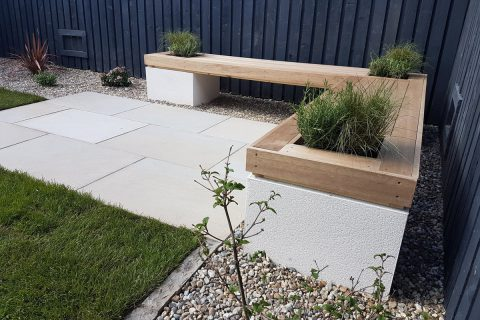 A hard wood top, rendered blockwork and fragrant planting complete the seat